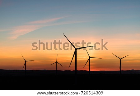 aerial view of the  sunset with wind turbines