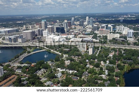 Aerial view of the thriving downtown Orlando, Florida skyline - stock photo