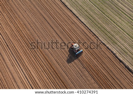 aerial view of the tractor working on the harvest field  in Poland - stock photo