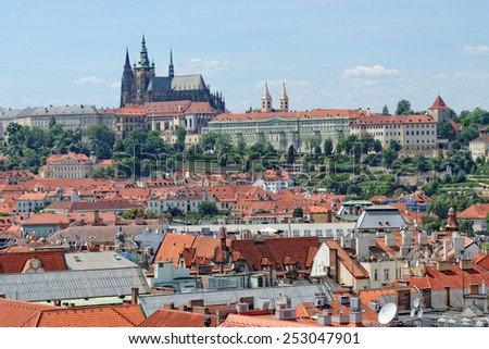Aerial view of the traditional red roofs of the city of Prague, Czech Republic, with Prague castle, Hradcany in the background.