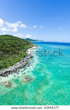 Aerial view of the tropical island with coral reefs and clear blue water, Kume Island, Okinawa, Japan