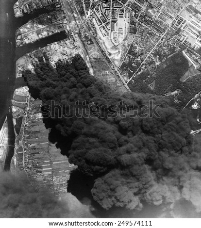 Aerial view of three oil refineries in Hamburg after bombing by U.S. 8th. Air Force. World War 2, June 20, 1944. - stock photo