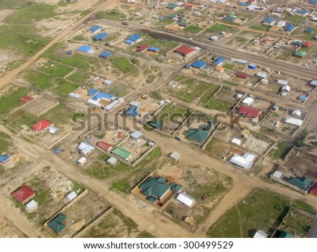 aerial view of tin shacks and dirt roads in Juba, capital of South Sudan - stock photo