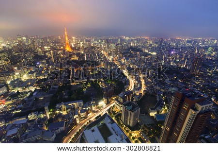 Aerial view of Tokyo with a view of Tokyo Tower in the background at night - stock photo