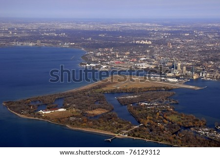 aerial view of Toronto Ontario with City Centre Airport in the foreground, Spring - stock photo