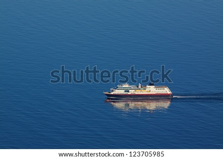 Aerial view of traditional norwegian cruise ship in tranquil blue ocean - stock photo