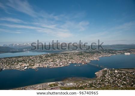 Aerial view of Tromso city, northern Norway. Famous bridge is called Tromso Bru. - stock photo