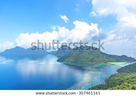 Aerial view of tropical island of Bohey Dulang near Siapdan Island, Sabah Borneo, Malaysia. - stock photo