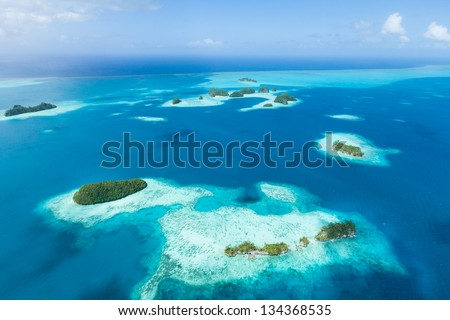 Aerial view of tropical paradise islands, coral reef and clear blue water, Palau, Micronesia - stock photo
