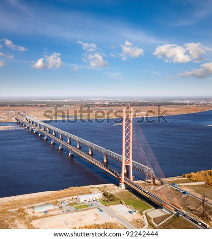 Aerial view of two bridges over the great river. - stock photo
