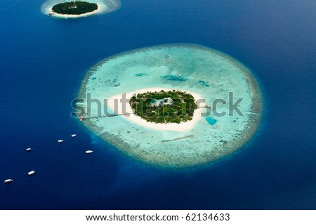 Aerial view of two Maldive islands and boats. - stock photo