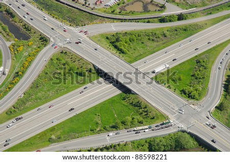 Aerial view of typical highway exits and overpass