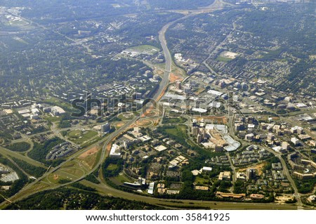 Aerial view of Tysons Corner, McLean, the commercial center of Northern Virginia in Fairfax County, near Washington DC, from the north. The Beltway (I-495) running from lower left corner up. - stock photo