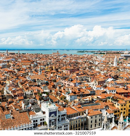 Aerial view of Venice. Houses, sea and palases from San Marco tower  - stock photo