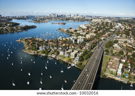 Aerial view of Victoria Road bridge and boats with distant downtown skyline in Sydney, Australia. - stock photo