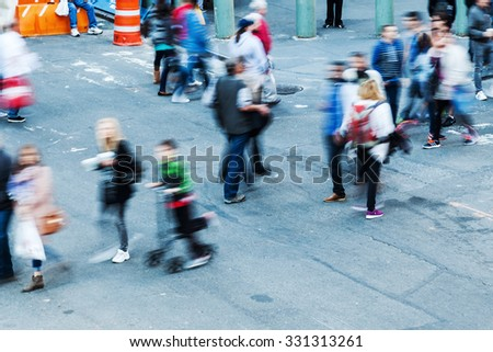 aerial view of walking people in the city in motion blur