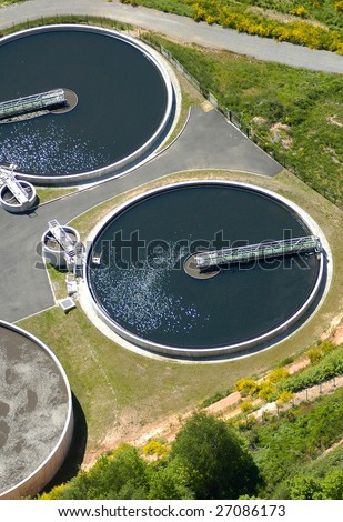 Aerial view of wastewater purification works bassins in France - stock photo
