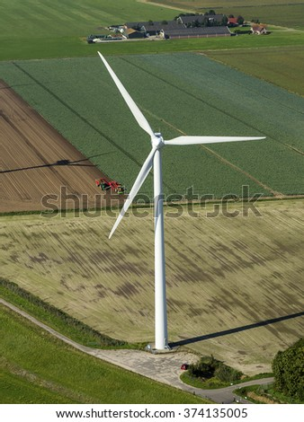 Aerial view of  wind turbine in a green field at Goerree-Overflakkee, Zeeland, The Netherlands.  - stock photo