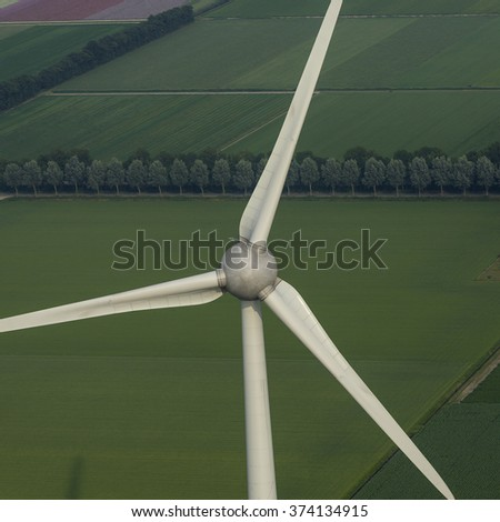 Aerial view of wind turbine in a green field near Urk, The Netherlands.  - stock photo