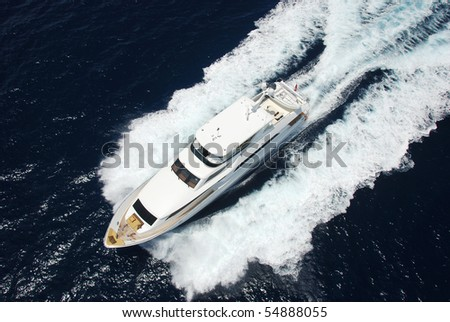 Aerial view of yacht running - stock photo