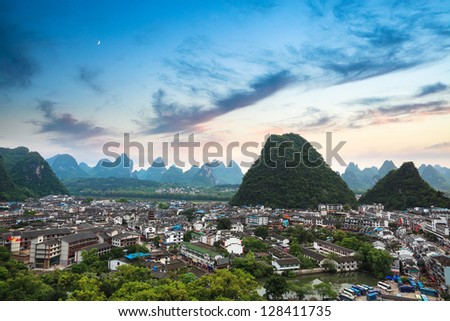 aerial view of yangshuo county town with sunset glow ,beautiful karst mountain scenery,China - stock photo