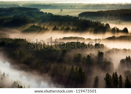 Aerial view of yearly misty morning in Lithuania - stock photo