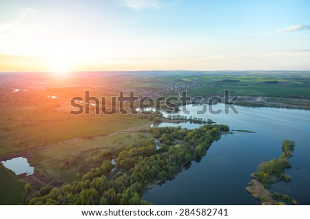 Aerial view on a sunset over the lake - stock photo