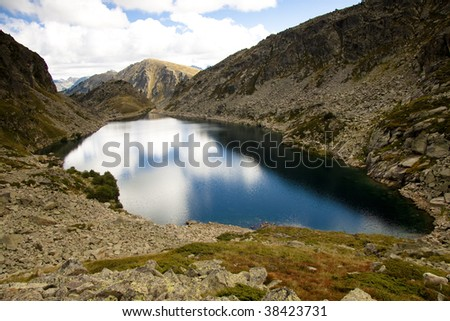 Aerial view on Couart lake in Andorra - Pyrenees. - stock photo