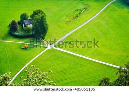 Aerial view on cultivated land divided by the crossing lanes. View from the Hohensalzburg castle, Salzburg, Austria