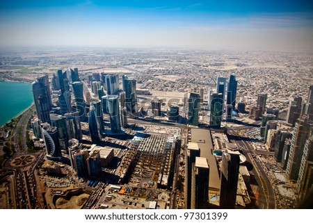 Aerial view on Doha - capital of  Qatar.  Contemporary towers on Doha Corniche in November 2011. - stock photo