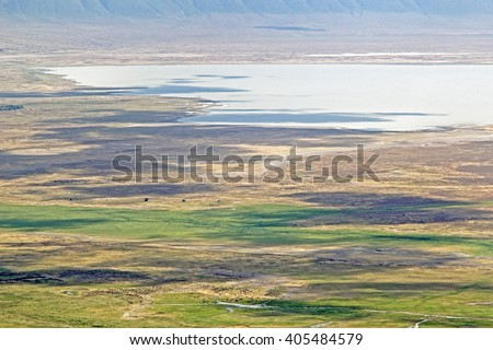 Aerial view on Ngorongoro Conservation Area in Tanzania. Clouds shadows on ground