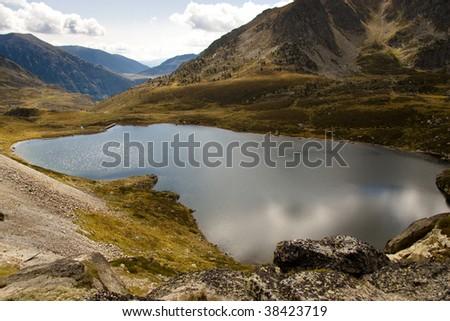 Aerial view on Pedourres lake in Andorra - Pyrenees mountain - stock photo