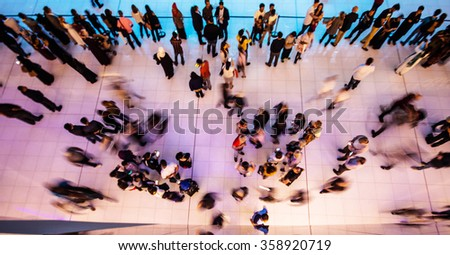 Aerial view on people in motion in a shopping center - stock photo