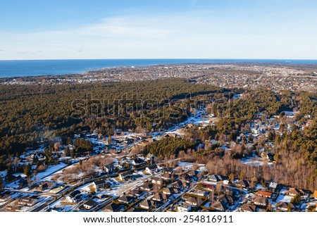 Aerial view on private houses in the forest Viimsi, Estonia - stock photo