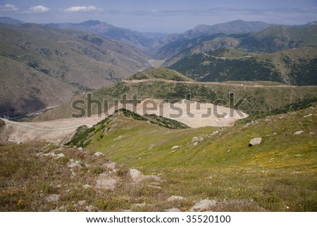 Aerial view on route in valley. Armenia summer day - stock photo