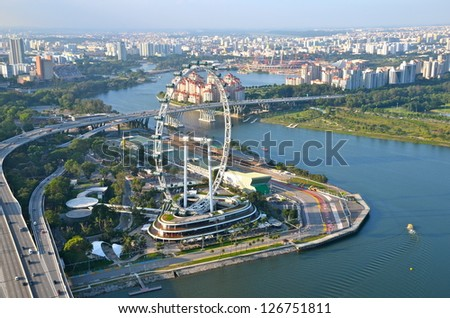 Aerial view on Singapore Flyer, Singapore river and the east side of the city - stock photo