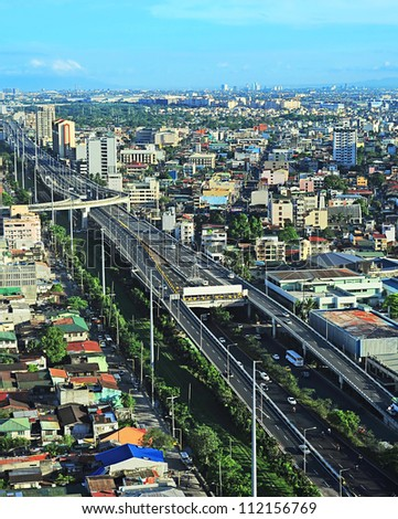 Aerial view on slum and highway in Metro Manila, Philippines - stock photo