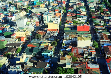 Aerial view on slum in Makati district - modern financial and business district of Metro Manila, Philippines - stock photo