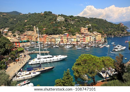 Aerial view on small bay and colorful houses at town of Portofino in Liguria, Italy. - stock photo