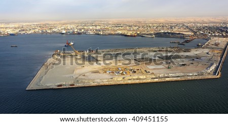 Aerial view on the coast in Namibia and cargo port of the city Walvis Bay in the Namib desert, Atlantic ocean, Africa