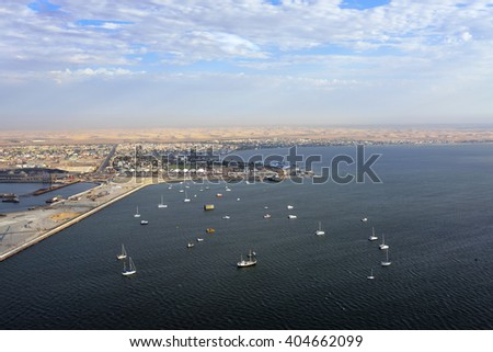 Aerial view on the coast in Namibia and port of the city Walvis Bay in the Namib desert, Atlantic ocean, Africa