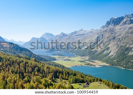 Aerial view on the Corvatsch hiking resort with Lake Silvaplana and Lake Sils, near St Moritz. - stock photo
