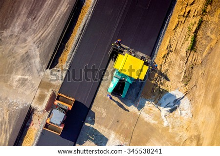Aerial view on the new asphalt road under construction - stock photo