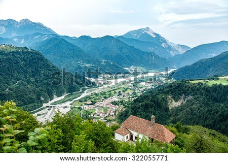 Aerial view on the small village in mountains - stock photo