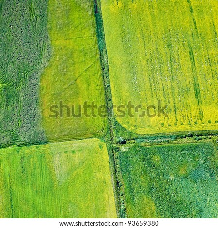 Aerial view over agricultural fields - stock photo