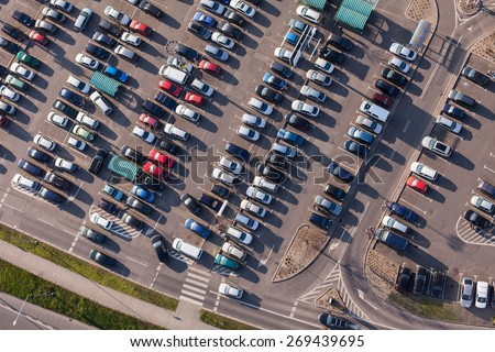 aerial view over crowded  parking lot near supermarket in Poland - stock photo