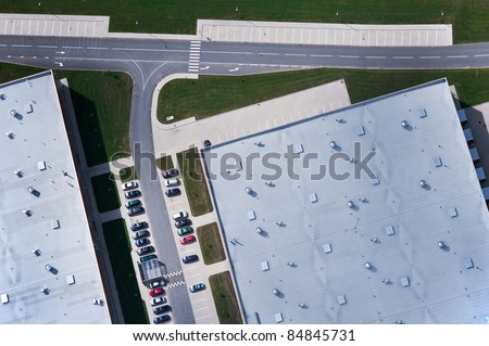 aerial view over industrial buildings - stock photo