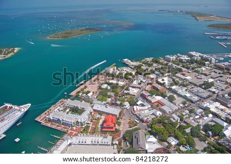 aerial view over northern key west including mallory square and cruise liner - stock photo