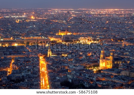 Aerial view over Paris at sunset from Montparnasse Tower, France - stock photo