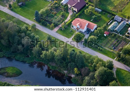 aerial view over private cottage - stock photo